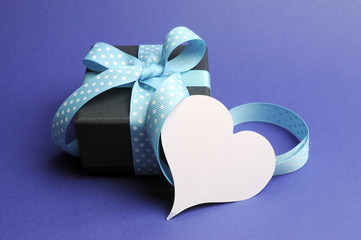 Beautiful blue elegant gift box with blank heart gift tag