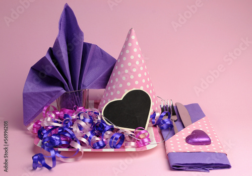 Pink and purple party table setting decorations