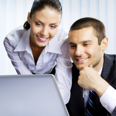 Two business people working with laptop