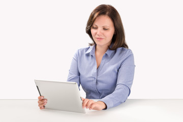 Business woman is working with tablet computer