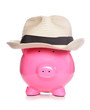 Piggy bank wearing a posh hat
