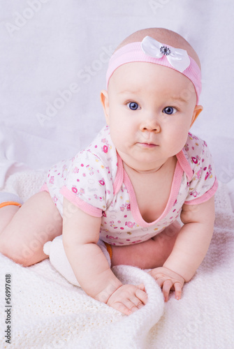 Baby with blue eyes smiling