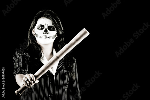 Woman in Halloween costume with a baseball bat