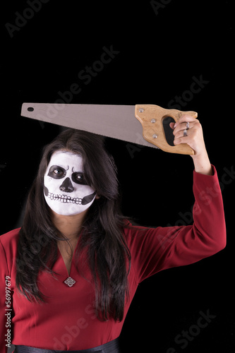 Woman in Halloween costume with a saw