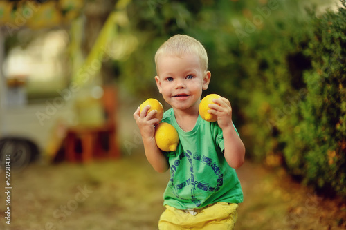 on the nature of the little boy in green t-shirt with mature lem