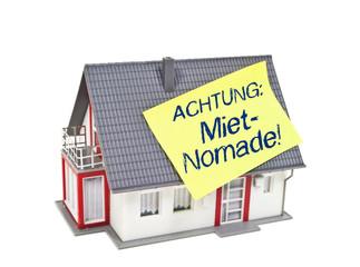 Haus mit Zettel und Mietnomade