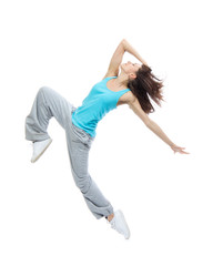 Modern teenage girl dancer jumping and dancing