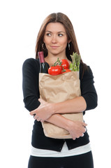 Young woman holding shopping bag with groceries vegetables