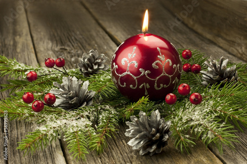 christmas composition with candle and decoration
