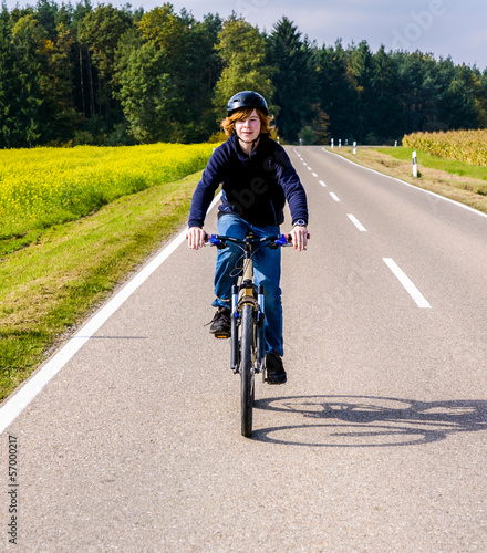 boy on a biycle ride on a small street in the countriside of Bav