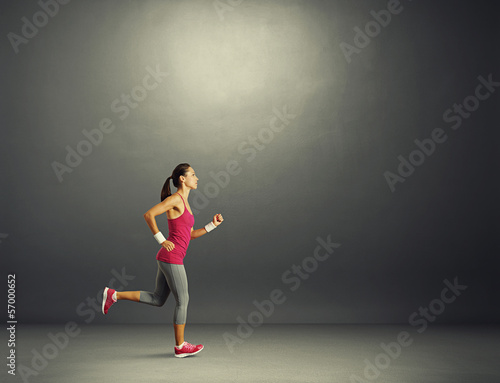 woman running in the dark room