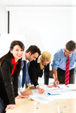 Business - People in office working as team