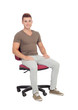 Casual young man sitting on an office chair