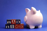 Pink piggy bank with Tax Time message