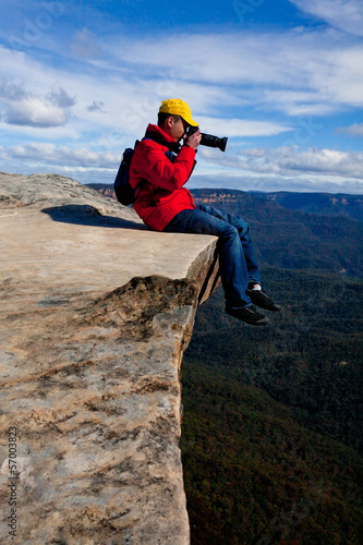 Tourist or photographer taking phots mountain landscape