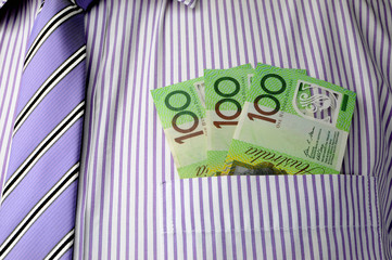 Three hundred dollar notes in business shirt pocket