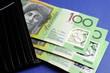 Australian hundred dollar notes out of black wallet