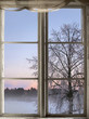 canvas print picture - winter sunset viewed through old window