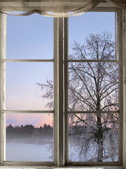winter sunset viewed through old window
