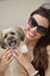 happy young woman with puppy have fun