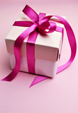 Beautiful pink present gift with candy fuschia pink ribbon