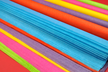 Rainbow colored reams of tissue wrapping paper