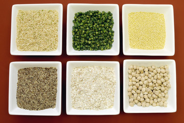 Gluten free grains foods in white square bowls