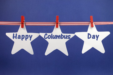 Happy Columbus Day bunting on pegs on a line.