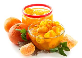Orange jam with zest and tangerines, isolated on white