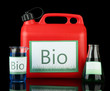 Bio fuels in canister and vials on black background