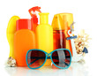 Bottles with suntan cream and sunglasses isolated on white