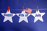 Happy Fourth of July stars from pegs on a line bunting