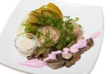Cold appetizer with jellied meat and pickled mushrooms