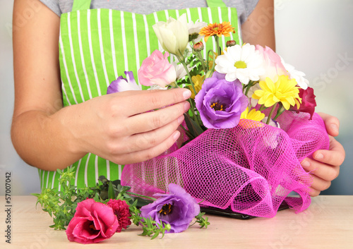 Florist makes flowers bouquet
