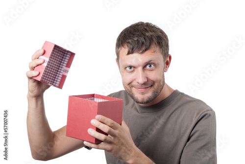 Bearded man opens a gift box on white background