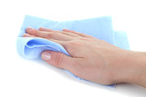 Hand wiping surface with blue rag isolated on white