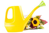 Watering can isolated with flowers