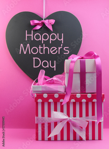 Stack of beautiful pink gifts for Happy Mothers Day