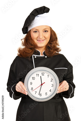 Chef woman showing clock