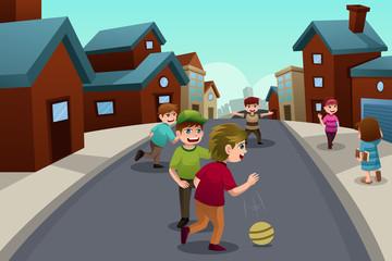 Kids playing in the street of a suburban neighborhood