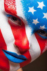 United States of America is painted on the face