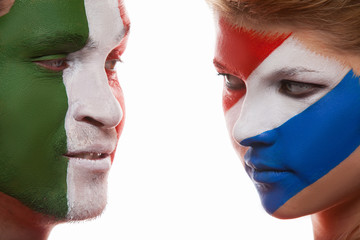 Couple with painted faces look at each other