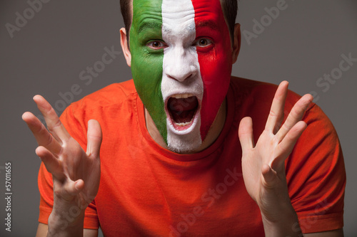 Italian football fan with painted face screaming