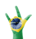 Hand making I love you sign, Brazil flag painted
