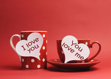 Red polka dot coffee tea cup mug with love messages on hearts