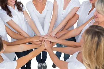 Female models joining hands in a circle