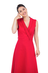 Glamorous model in red dress making phone call gesture