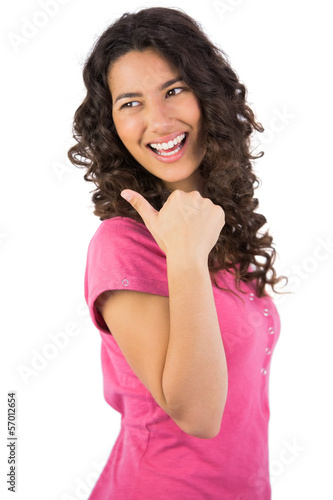 Dark haired young model posing thumb up