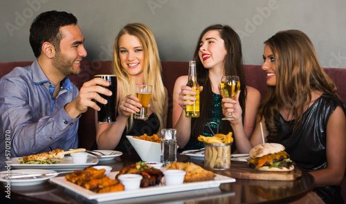 Friends having dinner together and toasting