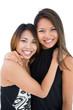 Two pretty young women posing